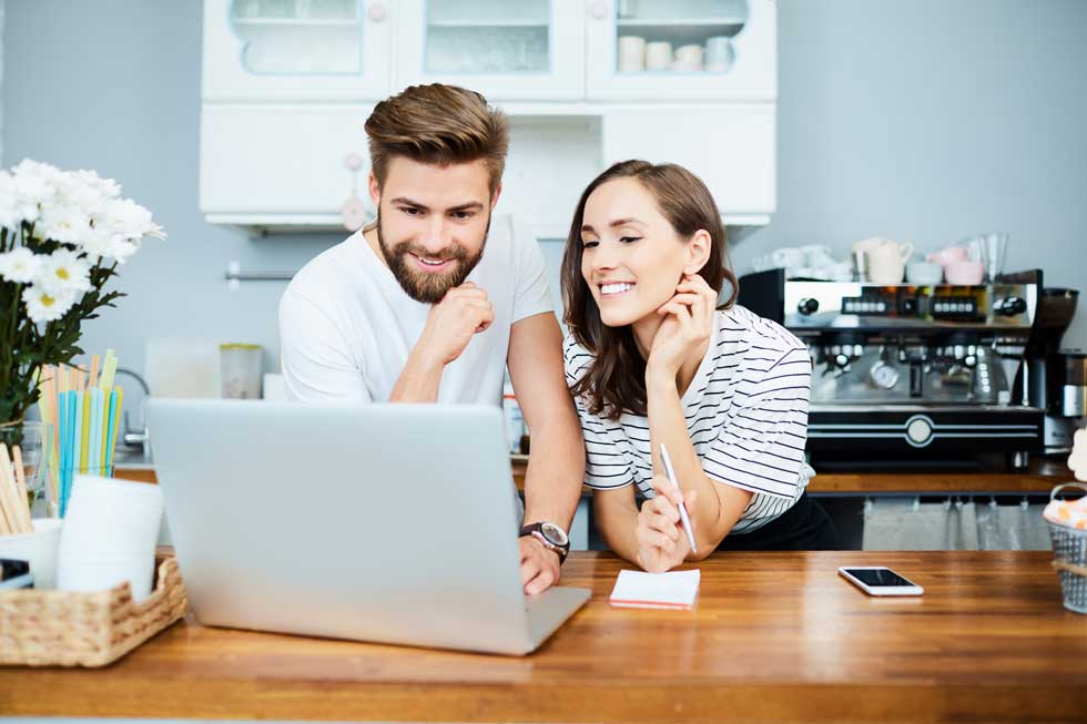 couple smiling at computer