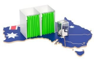two polling booths on top of map of Australia with Australian flag printed on top