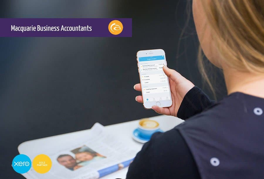 lady looking at Xero app on her smart phone