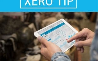 man holding ipad with Xero app open