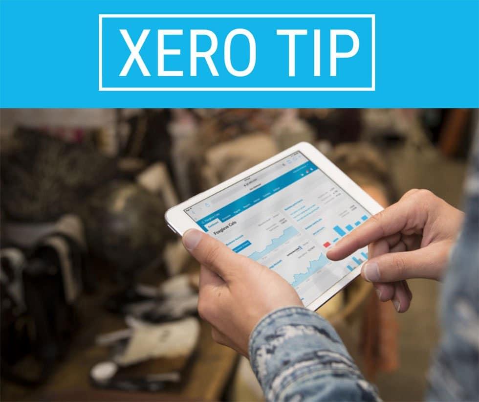 man holding ipad open on Xero app