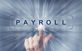 hand clicking on financial payroll button with zoom effect background