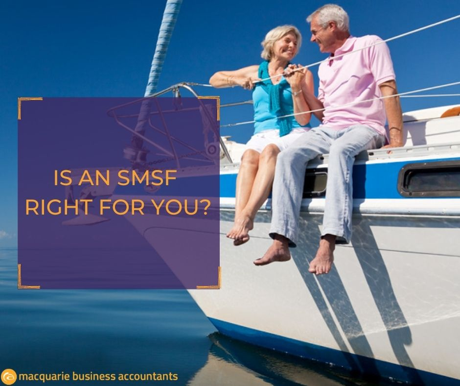 senior couple sitting on a yacht smiling at each other